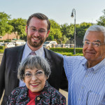 Board President John Dickey (left) with Cecelia and Charles Alcantar