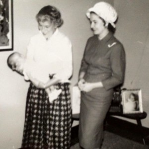 Hope Cottage social worker, Roz Katz, presents Baby Shannon to her new mother.
